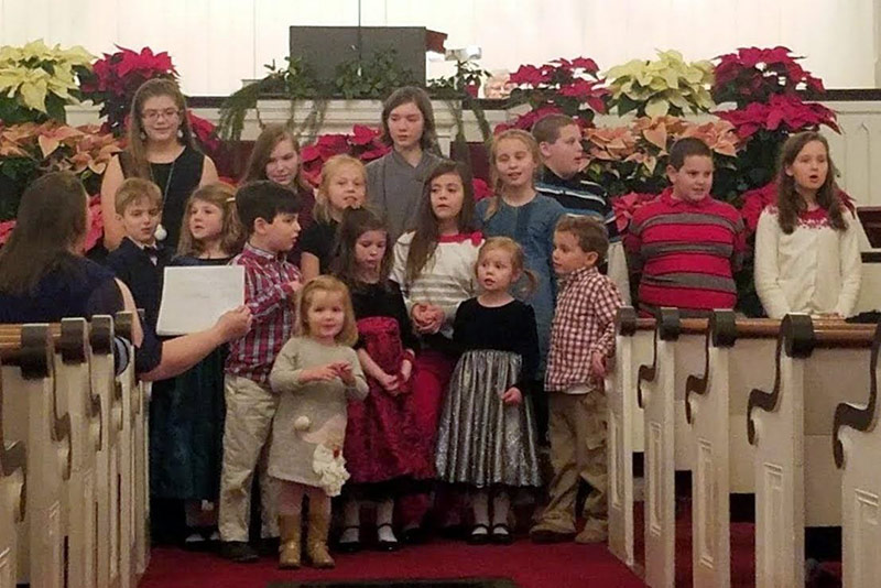 Children singing at the Christmas eve service