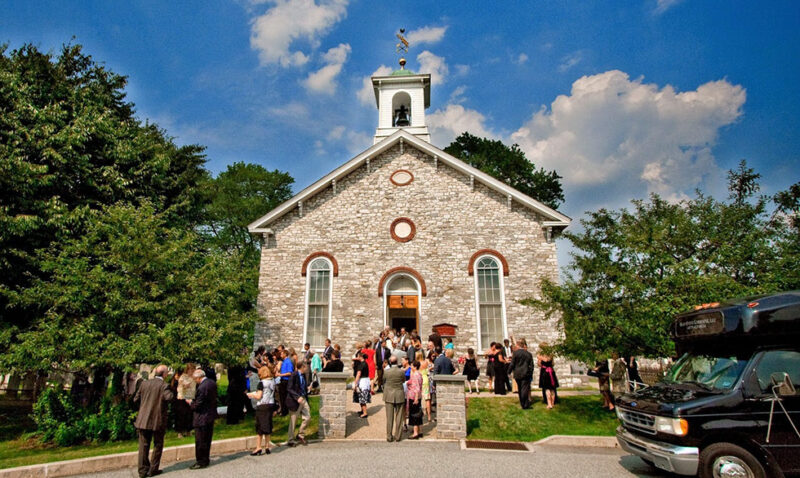 People Attending A Wedding At The Baptist Church In The Great Valley