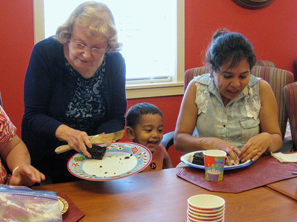 Members having cake at the church