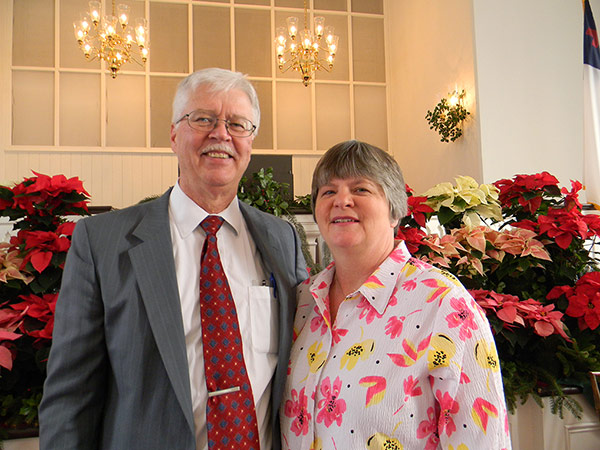 Pastor John Loring with his wife, Kim Loring, at Christmas