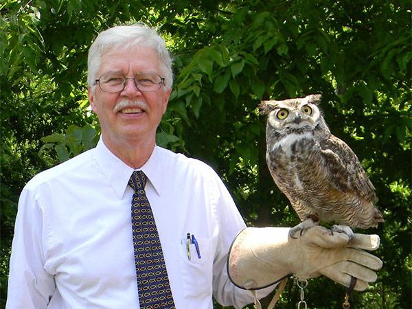 Pastor John Loring holding an owl