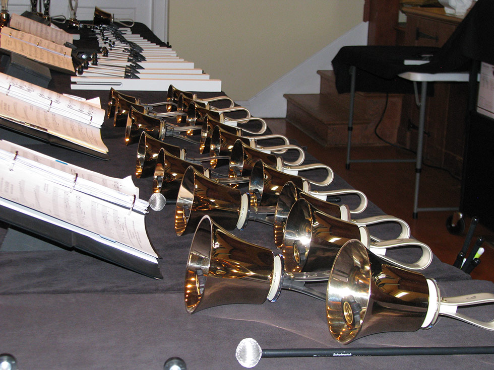 Bells On A Table With Sheet Music