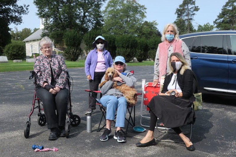 Church Members Wearing Masks Gathered In The Church Parking Lot