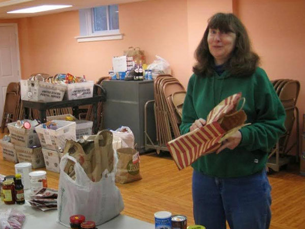 Carol Claypoole Director Of Food Cupboard Preparing A Distribution