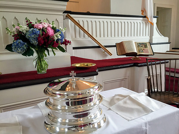 Communion Trays At The Alter With Flowers