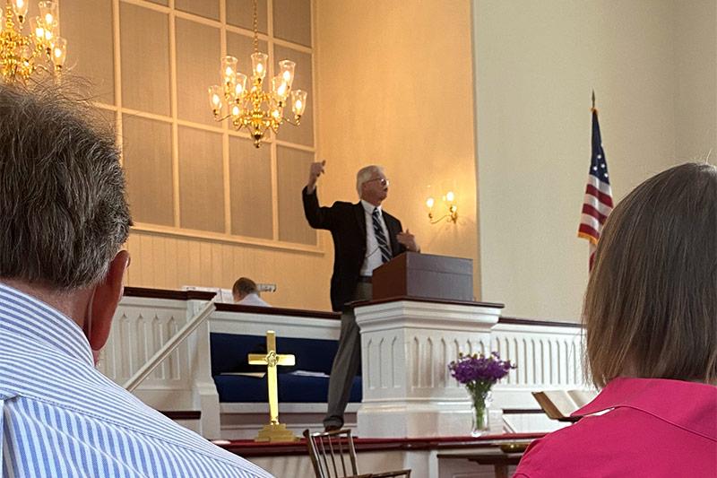 Pastor John Inside Church Giving Sermon At Sunday Worship