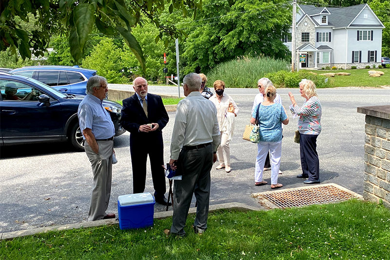 Church Members Outside The Church After Services