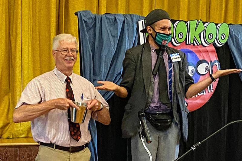 Photo Of Pastor John And KooKoo The Cartoon Magician